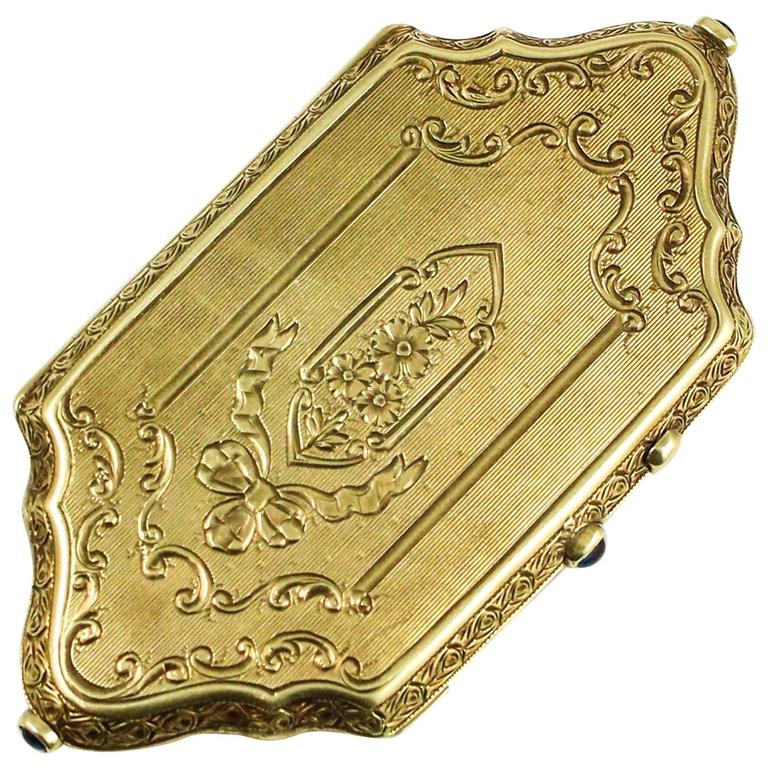 Exquisite Gold Engraved Compact With Sapphire Accents