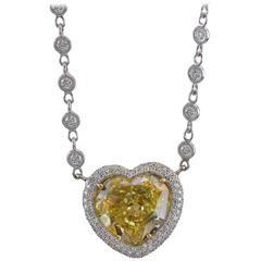 GIA Certified 7.77 Carat Yellow Heart Shape Diamond Reversible Gold Pendant