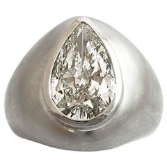 3.78 carat pear shaped diamond satin-finish white gold ring