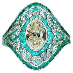 Emerald  Yellow Diamond Platinum Ring