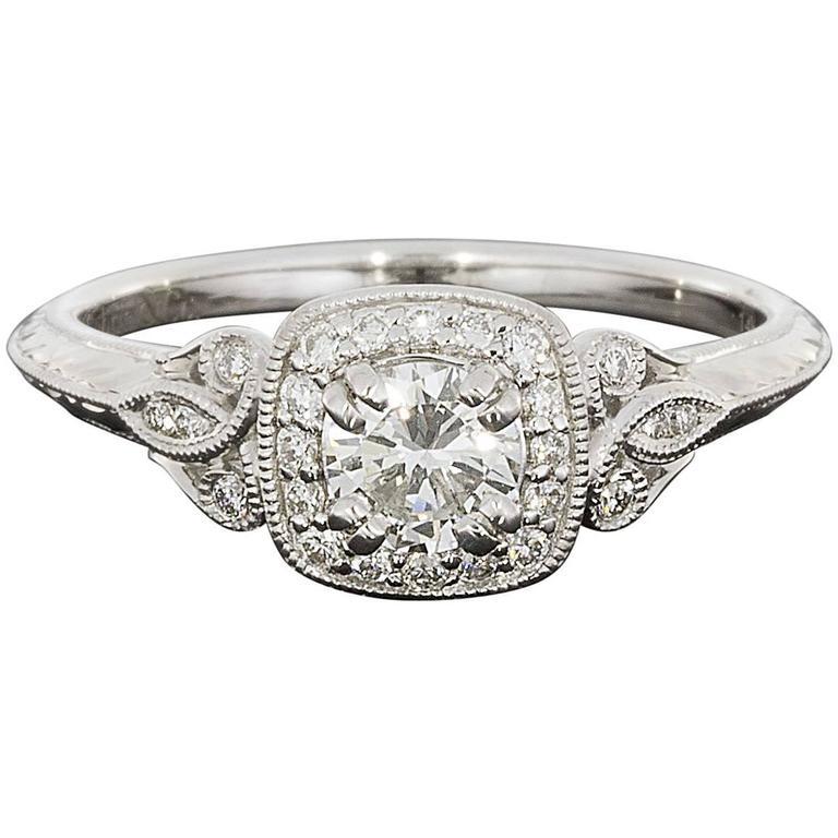 cushion halo fleur de lis engagement ring at
