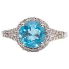 1.0 Carat Blue Topaz and Diamond Halo 14 Karat White Gold Ring