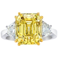 GIA Certified Fancy Yellow 7.38 Carat Emerald Cut Diamond Three-Stone Ring