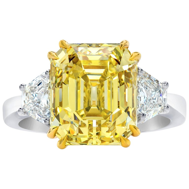 GIA Certified Fancy Yellow 7.38 Carat Emerald Cut Diamond Three-Stone Ring For Sale