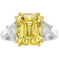 GIA Certified Fancy Yellow 7.38 Carat Emerald Cut Diamond Three-Stone Ring