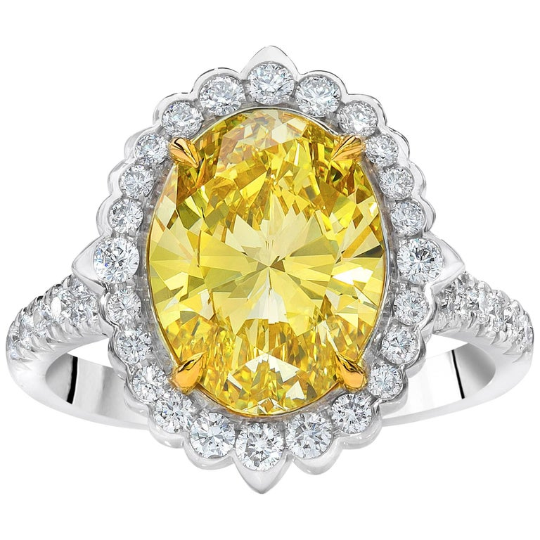 GIA Certified Fancy Intense Yellow Diamond Halo Engagement Ring For Sale
