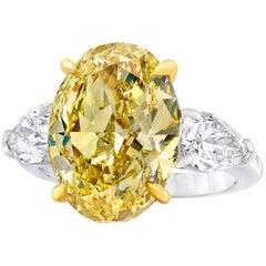 GIA Certified 8.88 Carat Fancy Yellow Diamond Three-Stone Engagement Ring