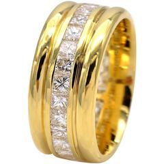Princess Cut Diamonds and Gold Eternity Ring