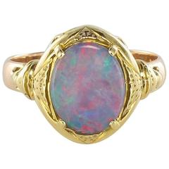 1900s Opal and 18 Carat Yellow Gold Ring