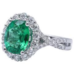 Emerald Diamond Halo Ring 18 Karat White Gold