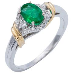 Two-Tone Oval Shape Emerald and Diamond Halo Ring