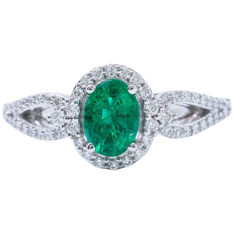 Oval Shape Emerald And Diamond Halo Engagment Cocktail