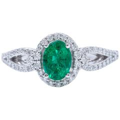Oval Shape Emerald and Diamond Halo Engagment Cocktail Ring