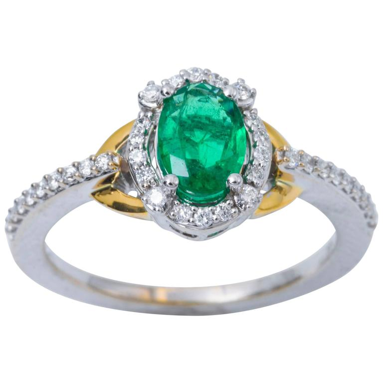 Oval Emerald and Diamond Halo White and Yellow Engagement Ring