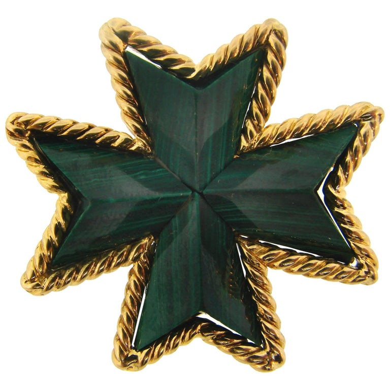 Colorful and elegant Maltese cross pin/pendant created by Tiffany & Co. in Italy.  It is made of 18 karat (stamped) yellow gold and carved malachite.  Measurements: 1-3/8 x 1-3/8 inches (3.4 x 3.4 centimeters). Weight 19.2 grams.  Stamped with