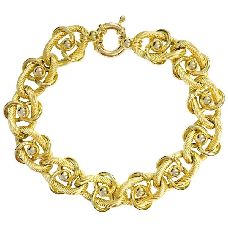 italian yellow gold stylized charm bracelet at 1stdibs