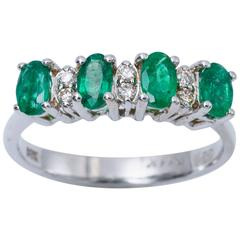 Four Oval Shape Zambian Emeralds and Diamonds Band Ring