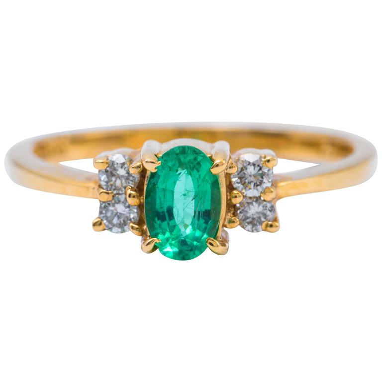 Oval Shaped Emerald and Diamond Engagement Ring in Yellow Gold 1