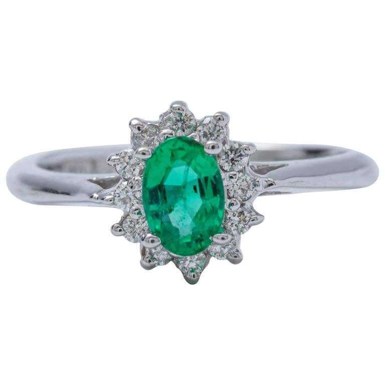 Oval Shape Emerald and Diamond Halo Engagement Ring