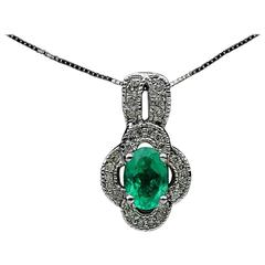 White Gold Oval Emerald and Diamond Scalloped Halo Pendant Necklace