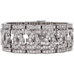 1980s Cartier Double 'C' Wide Diamond Gold Bracelet