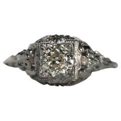 1930s 14 Karat White Gold GIA Certified .58 Carat Diamond Engagement Ring