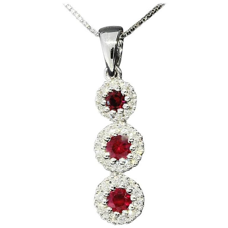 White Gold Ruby and Diamond Three Stone Halo Pendant Necklace