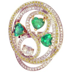 Tourbillon Ring in 18K White Gold Set With Emeralds and Diamonds