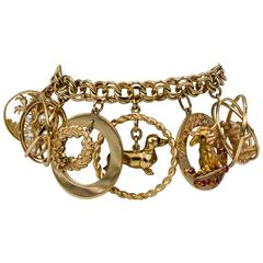 Classic 1980s Yellow Gold Nine Charm Bracelet