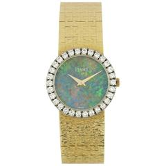 Piaget Ladies Yellow Gold Diamond Bezel Opal Dial Quartz Wristwatch