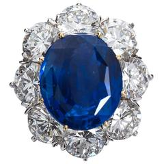 Unheated 7.28 Carat Oval Blue Sapphire Cluster Ring