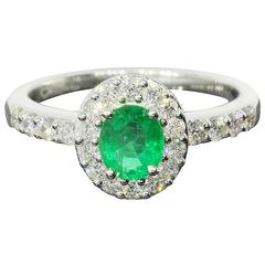 Oval Emerald Diamond Halo White Gold Engagement Ring