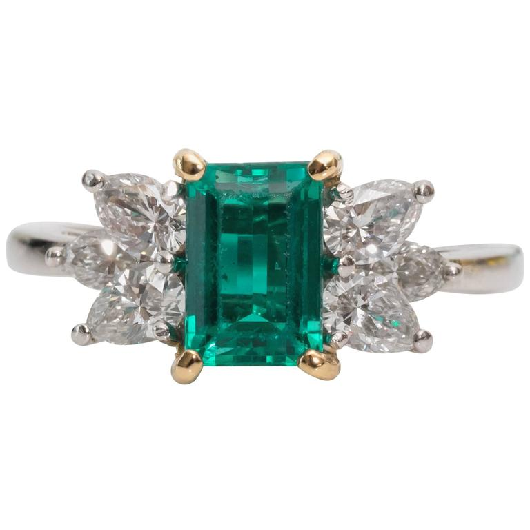 1980s Tiffany & Co. 1 Carat Emerald and Diamond Platinum Yellow Gold Ring