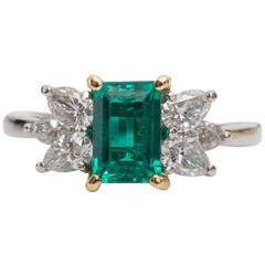 1980s Tiffany & Co. 1 Carat Emerald and Diamond Platinum Yellow Gold Ring