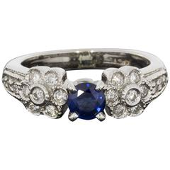 Blue Sapphire Diamond White Gold Flower Design Engagement Ring