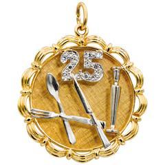 Diamond 14 Karat Yellow and White Gold Charm