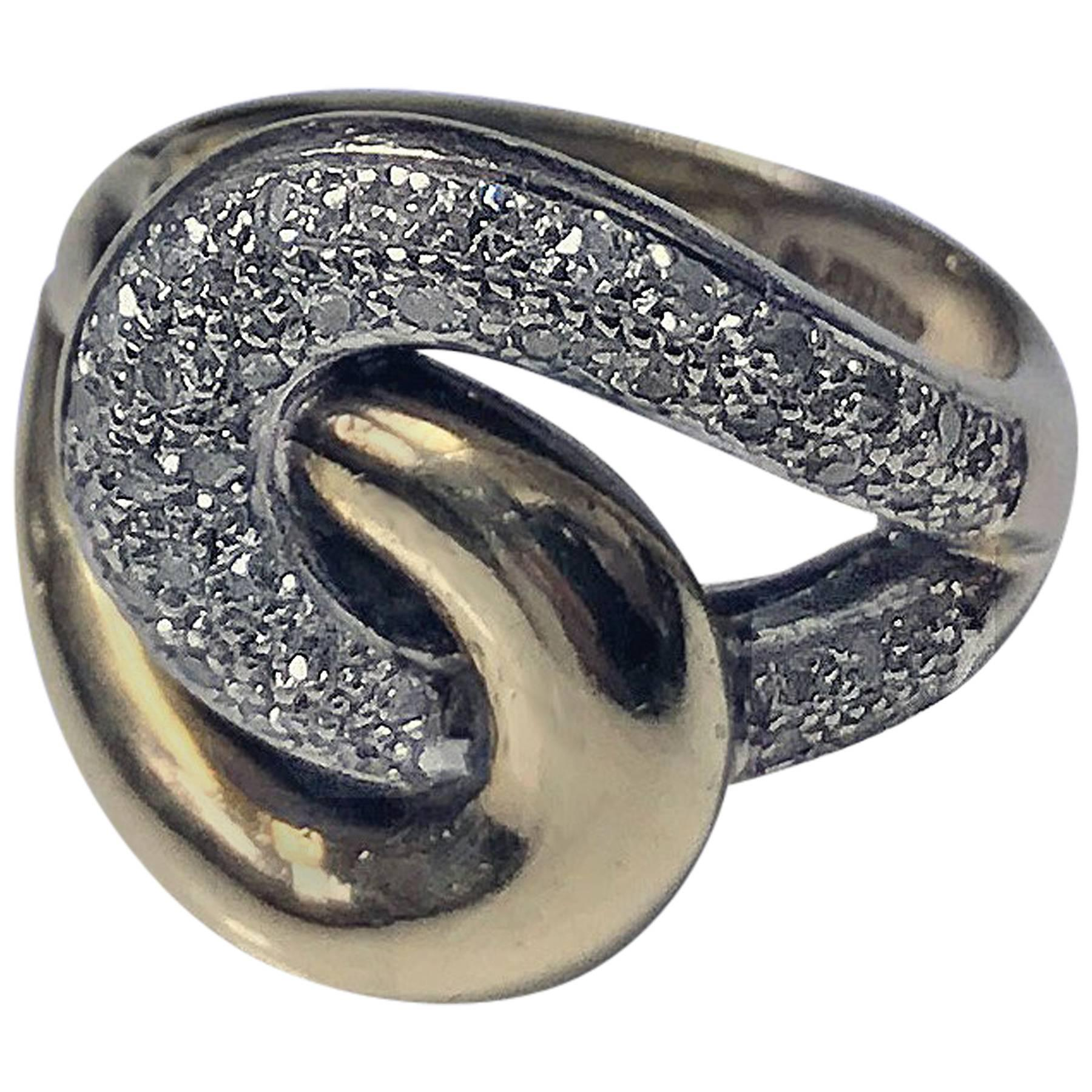 1970s 14 Karat Yellow and White Gold Diamond Twist Ring