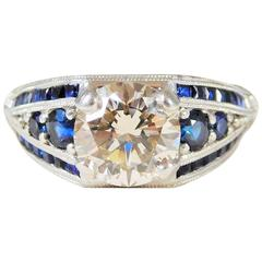 Ornate Custom-Made Sapphire and Champagne Colored Diamond Platinum Ring