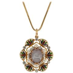 1930s 12.00 Carat Star Sapphire, Diamond, Enamel and Pearl Pendant