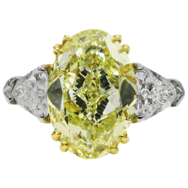 4.66 Carat GIA Certified Fancy Yellow Oval Diamond Platinum Ring