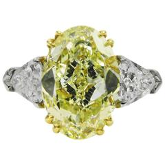 4.66 Carat GIA Certified Fancy Yellow Oval Diamond Platinum Ring