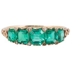 Ring,19th Century Emerald and Gold Carved Half Hoop , circa 1880