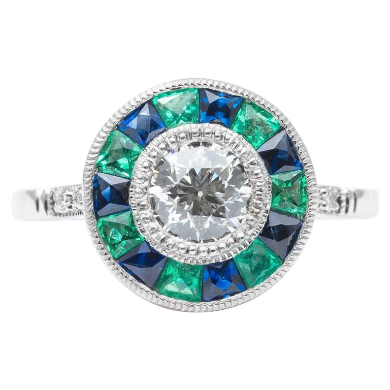 exciting emerald sapphire and target ring in