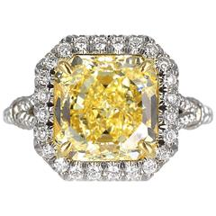 3.69 Carat GIA Certified Fancy Yellow Radiant Cut Diamond Platinum Ring