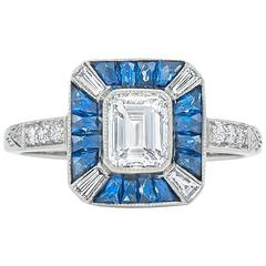 0.81 Carat Emerald Cut Diamond and Sapphire Ring