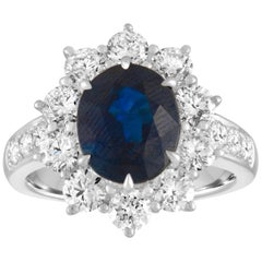 AGL Certified 4.07 Carat No Heat Oval Blue Sapphire and Diamond Ring