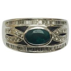 Elegant Emerald Diamond Platinum Tapered Ring