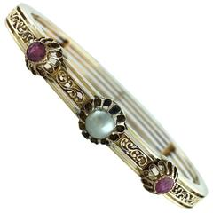 Early 20th Century Ruby Pearl Gold Bangle Bracelet