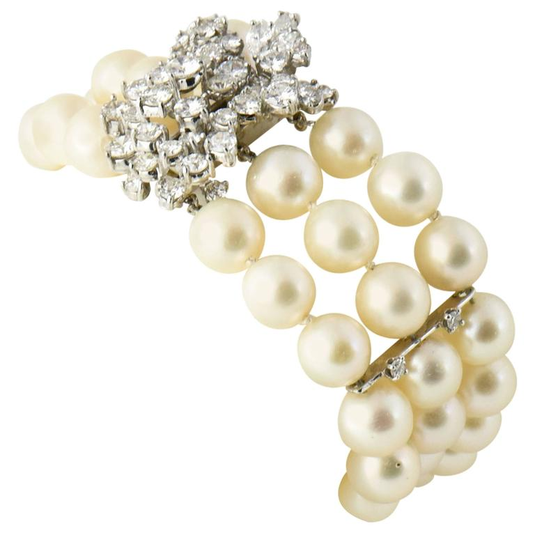 Mid-20th Century Triple Strand Cultured Pearl and Diamond White Gold Bracelet