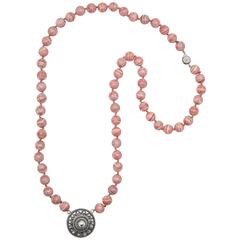 Rhodochrosite Beaded Necklace with Silver Rondelle Pendant